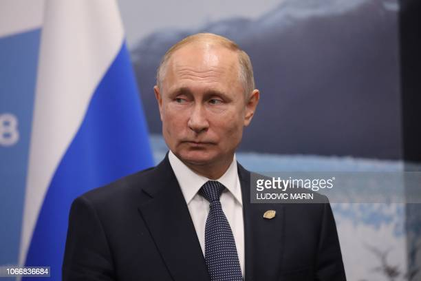 Russia's President Vladimir Putin gestures during a meeting with France's President Emmanuel Macron in the sidelines of the G20 Leaders' Summit in...