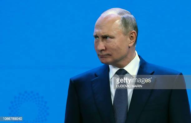 Russia's President Vladimir Putin getsures during the G20 Leaders' Summit family photo on November 30 2018 in Buenos Aires Global leaders gather in...