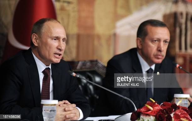 Russia's president Vladimir Putin gives a press conference with Turkish Prime minister Recep Tayyip Erdogan in Istanbul on December 3 as part of...