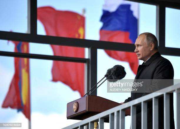 Russia's President Vladimir Putin gives a speech at the parade of the participants of the Vostok2018 military drills at Tsugol training ground not...