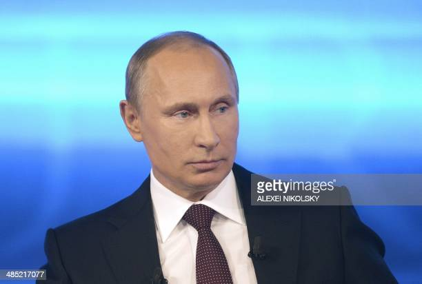Russia's President Vladimir Putin gives his annual televised questionandanswer session with the nation in Moscow on April 17 2014 Putin accused today...