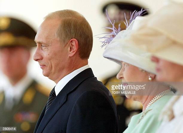 Russia's President Vladimir Putin (L stands next to Britain's Queen Elizabeth II at Horse Guards in London 24 June 2003. Putin landed in Britain 24...