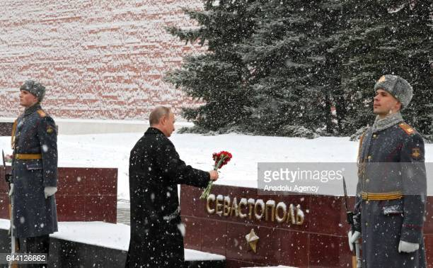 Russia's President Vladimir Putin lays flowers at the Memorial Stone Defenders Sevastopol near the Tomb of the Unknown Soldier in Moscow's Alexander...