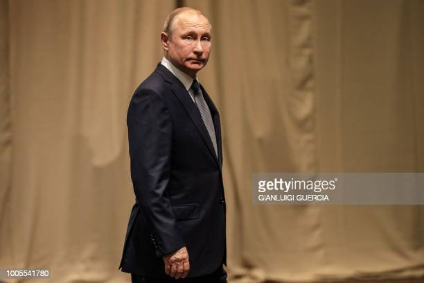 Russia's President Vladimir Putin leaves after posing for a group picture during the 10th BRICS summit on July 26, 2018 at the Sandton Convention...