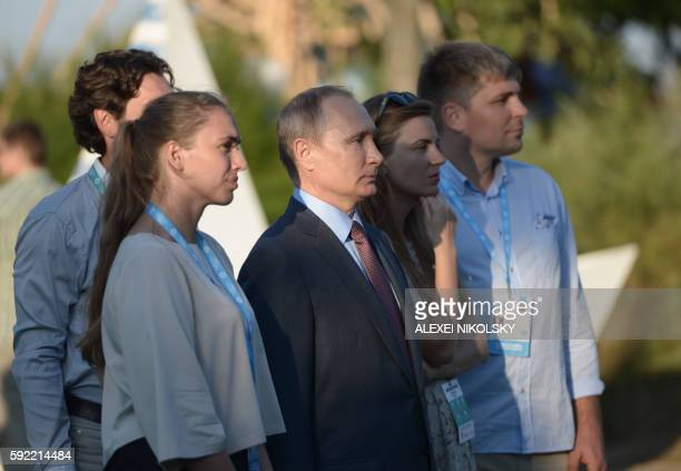 Russia's President Vladimir Putin looks on as he visits the youth educational forum 'Tavrida' in Crimea on August 19 2016