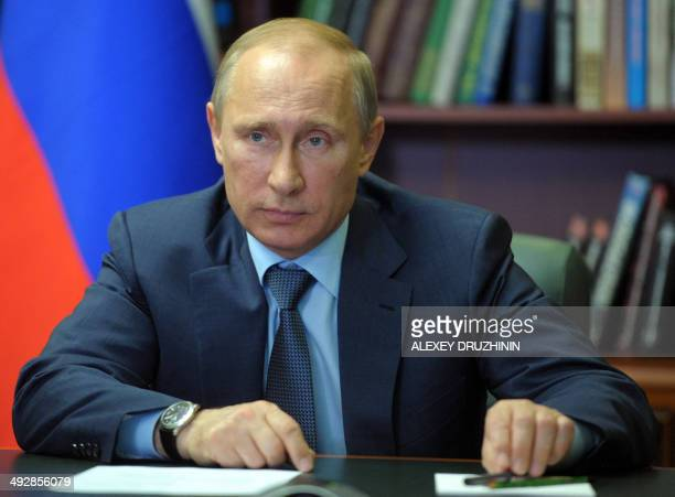 Russia's President Vladimir Putin looks on somewhere in the undisclosed location in the Amur Region on May 22 during a video link with the Vostochny...