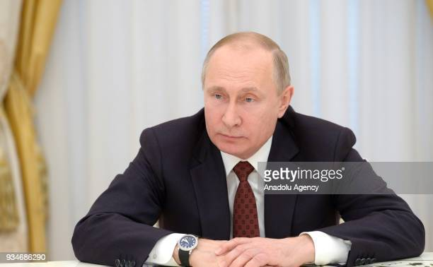 Russia's President Vladimir Putin meets with candidates in the 2018 Russian presidential election at Moscow's Kremlin in Moscow Russia on March 192018