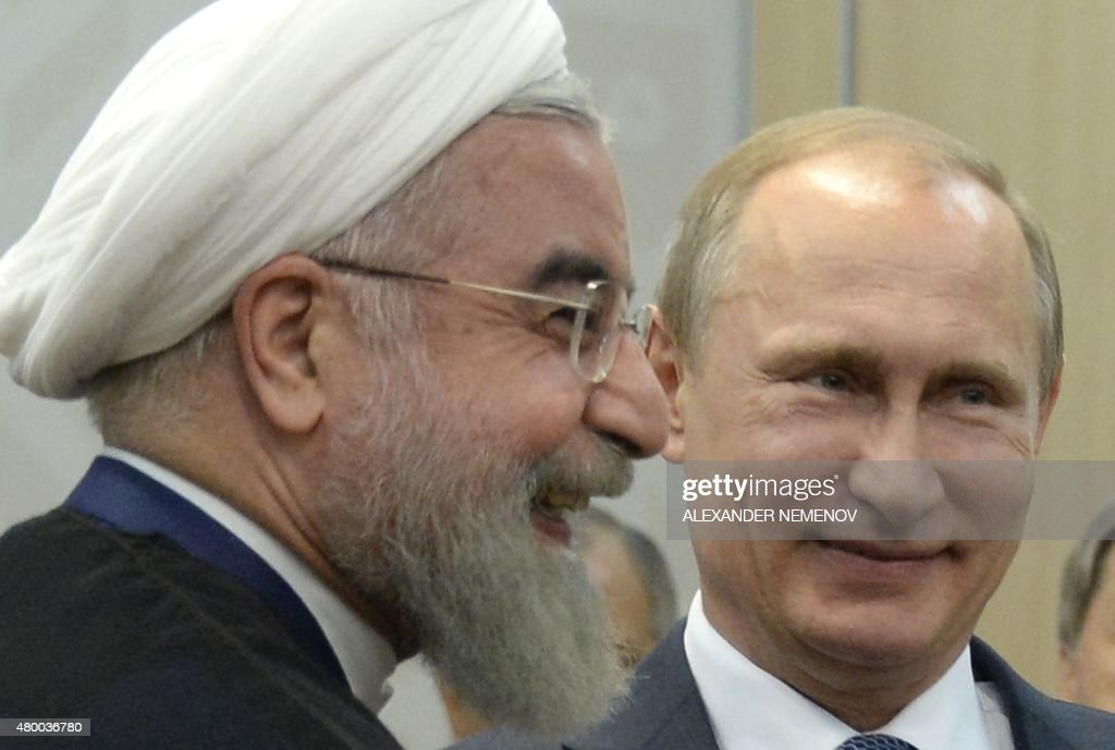 Russias President Vladimir Putin (R) meets with Iran's President Hassan Rouhani on the sidelines of the 7th BRICS summit in Ufa on July 9, 2015.