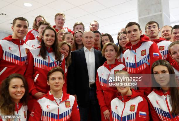 Russia's President Vladimir Putin meets with members of the Russian national team, who take part in the 29th Winter Universiade in Krasnoyarsk, on...