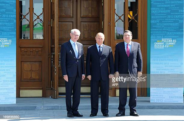 Russia's President Vladimir Putin poses for a photo with EU President Herman Van Rompuy and EU Commission head Jose Manuel Barroso ahead of the...