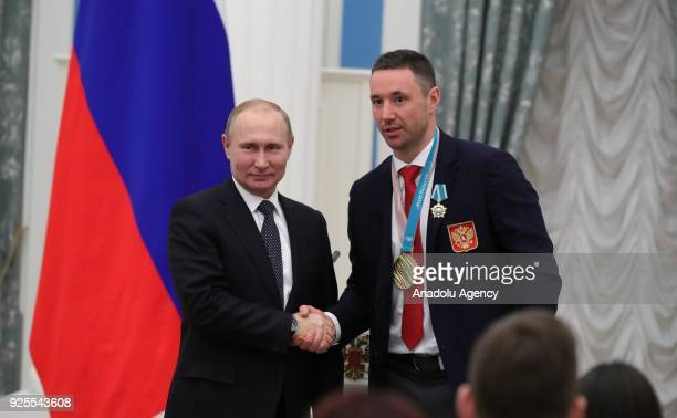 Russia's President Vladimir Putin presents Olympic champion ice hockey player Ilya Kovalchuk with an Order of Friendship at a ceremony to award...