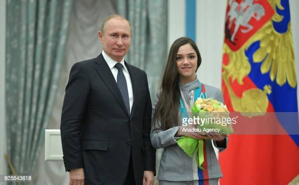 Russia's President Vladimir Putin presents Olympic silver medallist, figure skater Evgenia Medvedeva with an Order of Friendship at a ceremony to...