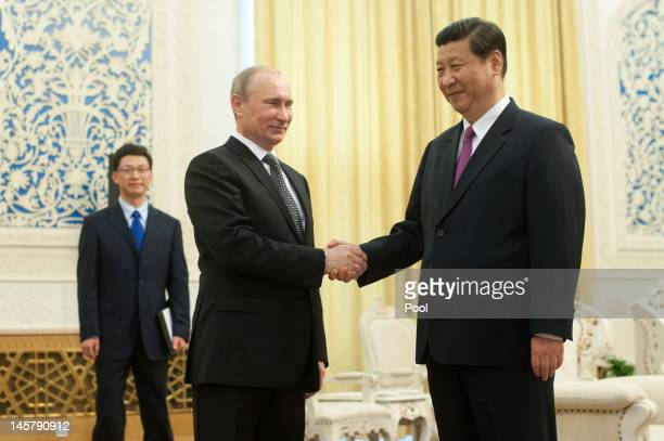 Russia's President Vladimir Putin shakes hands with China's Vice President Xi Jinping prior to a meeting at the Shanghai Cooperation Organisation...