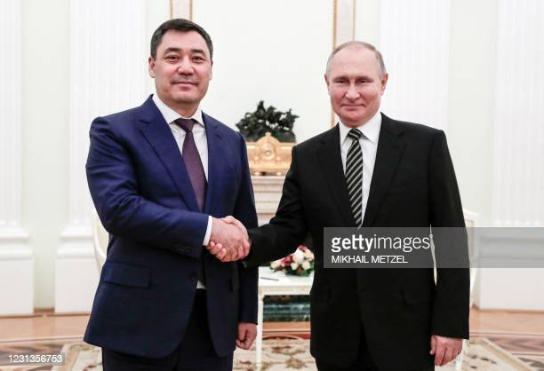 Russia's President Vladimir Putin shakes hands with Kyrgyzstan's President Sadyr Japarov during their meeting at the Kremlin, in Moscow, on February...