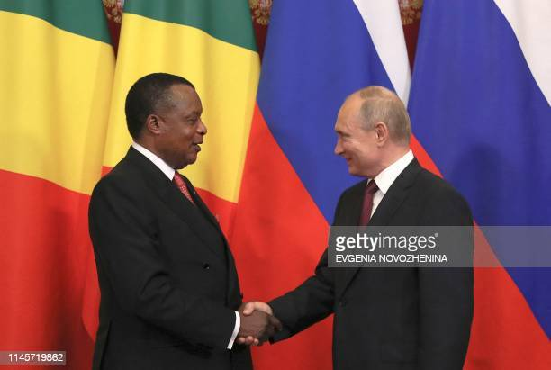 Russia's President Vladimir Putin shakes hands with the Congolese President Denis Sassou Nguesso during a signing ceremony following their talks at...