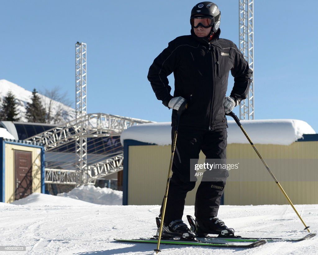 Russia's President Vladimir Putin skis in the mountain Laura Cross Country and Biathlon Centre near the Black Sea resort of Sochi, on January 3, 2014. Sochi will host the 2014 Winter Olympics that start on February 7, 2014.