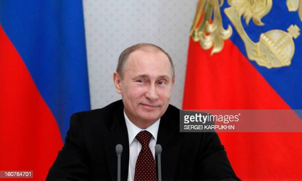 Russia's President Vladimir Putin smiles during a meeting in his residence in the Black Sea resort of Sochi Russia on February 5 2013 Putin discussed...
