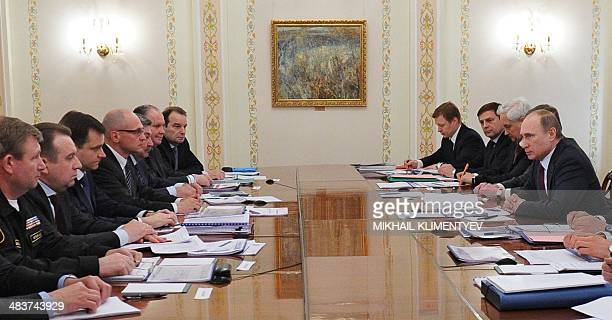 Russia's President Vladimir Putin speaks at a meeting with top officials on gas deliveries to Ukraine in his NovoOgaryovo state residence outside...