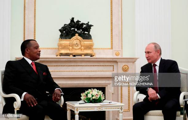 Russia's President Vladimir Putin speaks with Congolese President Denis Sassou Nguesso during their meeting at the Kremlin in Moscow on May 23 2019