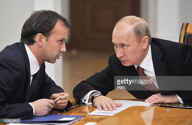 Russia's President Vladimir Putin speaks with deputy prime minister Arkady Dvorkovich during a meeting in the NovoOgaryovo residence outside Moscow...