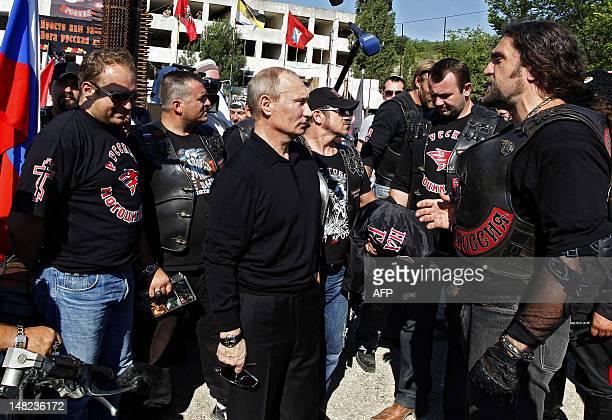 Russia's President Vladimir Putin speaks with the leader of Nochniye Volki biker group Alexander Zaldostanov also known as Khirurg as they meet in...