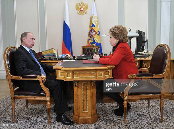 Russia's President Vladimir Putin speaks with the upper house Federation Council speaker Valentina Matviyenko during their meeting at the...