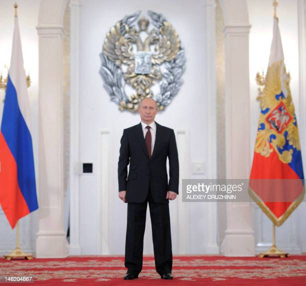 Russia's President Vladimir Putin stands at Georgiyevsky hall in the Great Kremlin Palace in Moscow, on June 12 during an awarding ceremony marking...