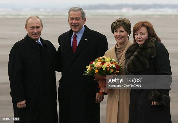 Russia's President Vladimir Putin US President George W Bush the first lady Laura Bush Putin's wife Lyudmila Putina during a refueling stop at...