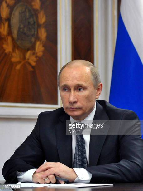 Russia's President Vladimir Putin visits a navy ship in the Barents Sea Russian naval base of Severomorsk on January 10 2013 A 14yearold Russian...