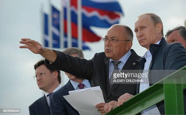 Russia's President Vladimir Putin visits the NizhneBureiskaya hydropower plant in the Amur Region on May 22 2014 Putin announced earlier this week...