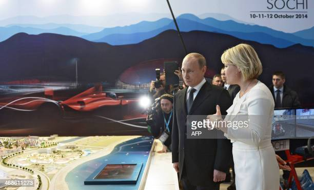 Russia's President Vladimir Putin visits the Sochi Olympic park's media centre at the Sochi 2014 Olympic Winter Games in Sochi on February 11 2014...