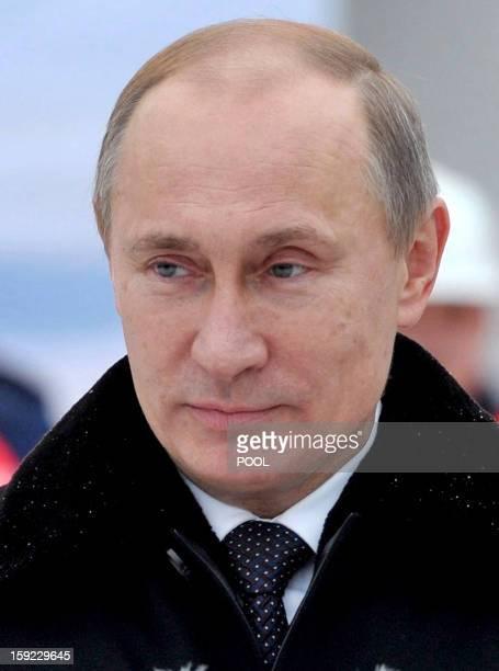Russia's President Vladimir Putin visits the Vitus Bering nuclearpowered icebreaker in the Russian northwest city of St Petersburg on January 10 2013...
