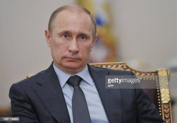 Russia's President Vladimir Putin watches an unveiling ceremony of the second leg of the Eastern Siberia Pacific Ocean oil pipeline during a live...