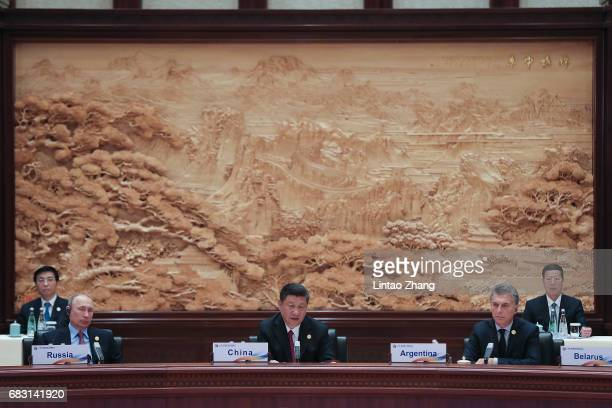 Russia's President Vladimir Putin with Chinese President Xi Jinping and Argentinian President Mauricio Macri attends the Roundtable Summit Phase One...