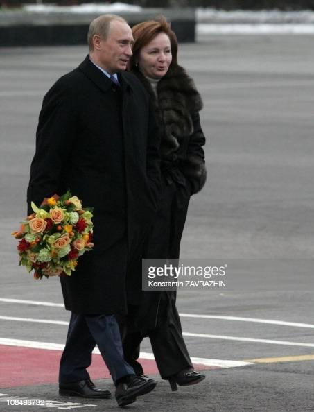 Russia's President Vladimir Putin with flowers, and Putin ...