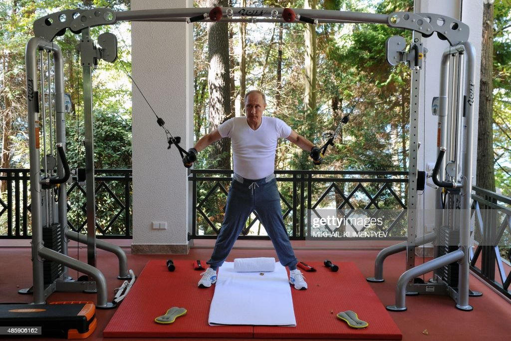 Russias President Vladimir Putin works out at a gym at the Bocharov Ruchei state residence in Sochi on August 30, 2015.