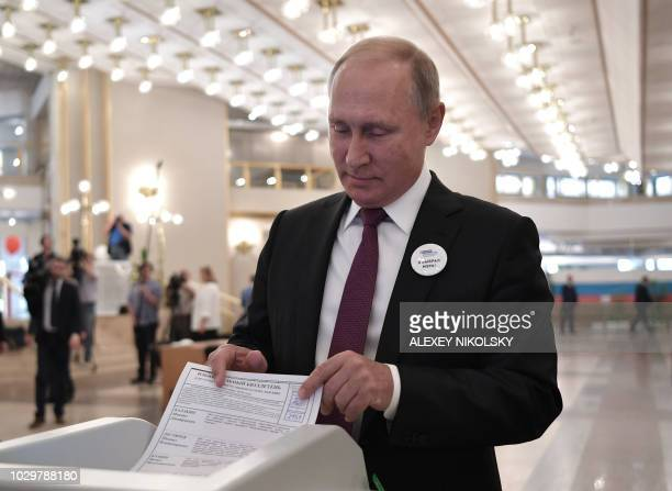 Russia's President Vladimir Putn casts his ballot at a polling station in Moscow on September 9 2018 during regional elections that Kremlinloyal...