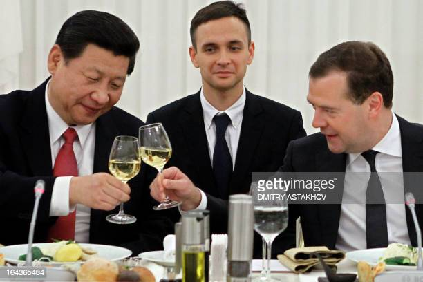 Russia's Prime Minister Dmitry Medvedev and China's President Xi Jinping toast during a breakfast in Gorky residence outside Moscow on March 23 2013...