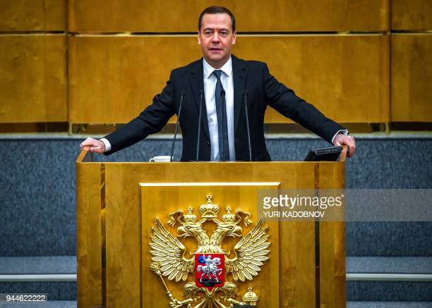 Russia's Prime Minister Dmitry Medvedev delivers a speech at the lower house of Russian parliament the State Duma in Moscow on April 11 2018 / AFP...