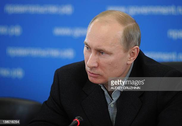 Russia's Prime Minister Vladimir Putin chairs a meeting with officials during his visit to the city of Tambov, on January 31, 2012. AFP PHOTO/...