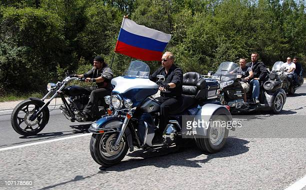Russia's Prime Minister Vladimir Putin rides Harley Davidson Lehman Trike as he arrives for the meeting with Russian and Ukrainian motorbikers at...
