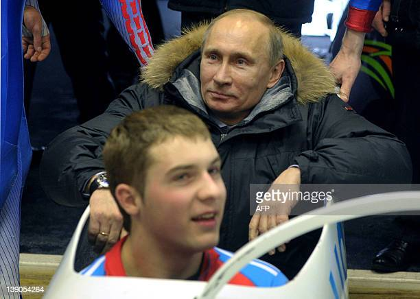 Russia's Prime Minister Vladimir Putin sits in a bob as he attends a training session of the Russian National Team during Putin's visit to Paramonovo...