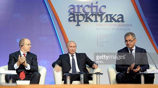 Russia's Prime Minister Vladimir Putin sits next to Albert II Sovereign Prince of Monaco and Sergei Shoigu Minister of Civil Defense Emergency...
