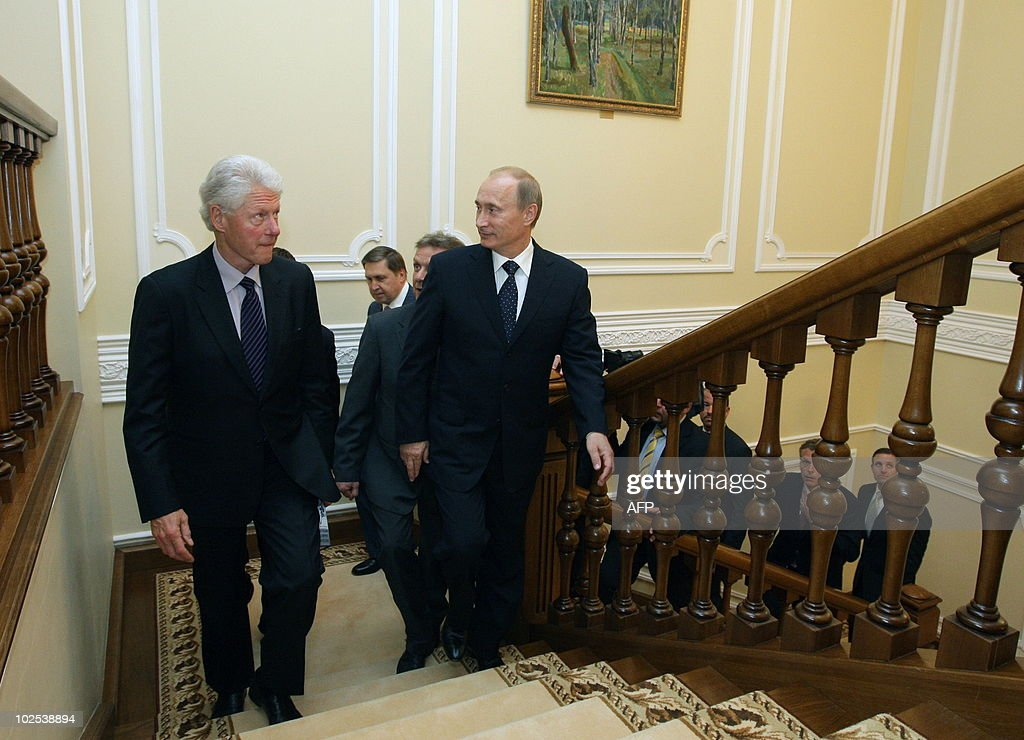 Russia's Prime Minister Vladimir Putin (R) walks with former US President Bill Clinton at the State residence of the Russian President Novo-Ogaryovo outside Moscow on June 29, 2010. Russia bristled at US claims that it had smashed a Cold War-style Russian spy ring as former KGB spy and Prime Minister of Russia Vladimir Putin expressed hope the scandal would not damage improving bilateral relations.