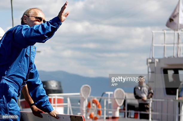 Russia's Prime Minister Vladimir Putin waves onboard of Mir2 minisubmersible on which he intends to dive into the depths of Lake Baikal during his...