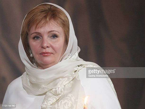 Russia's Prime Minister Vladimir Putin's wife Lyudmila Putina pray during an Orthodox Easter service in the Christ the Saviour Cathedral on April 24...
