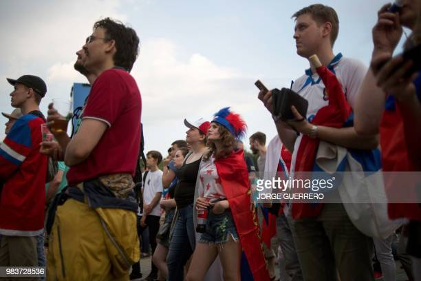 Russia's react as they watch, on a giant screen at the Fans Zone, the football match between Uruguay and Russia in Ekaterinburg on June 25, 2018...