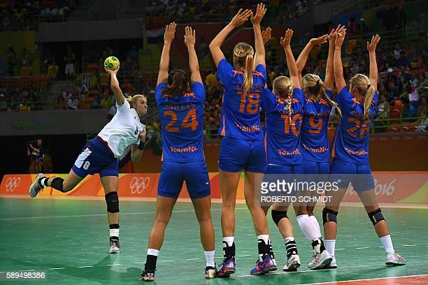 TOPSHOT Russia's right back Anna Sen executes a free throw past Dutch defenders during the women's preliminaries Group B handball match Netherlands...