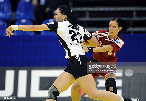 Russia's rightback Anna Punko is pushed by Hungary's Anita Görbicz during the 2012 EHF European Women's Handball Championship Group II match of main...