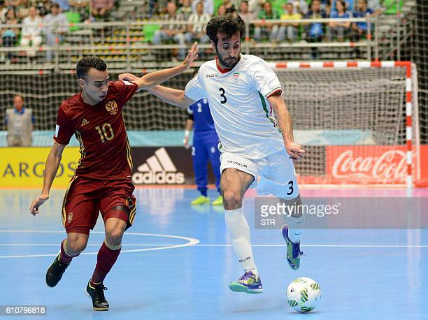 Russia's Robinho vies for the ball with Iran's Ahmad Esmaeilpour during their Colombia 2016 FIFA Futsal World Cup semifinal match in Medellin...